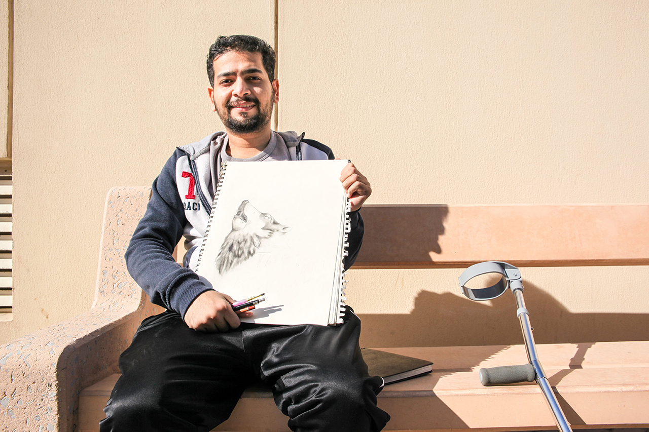 Ahmed showing his drawing