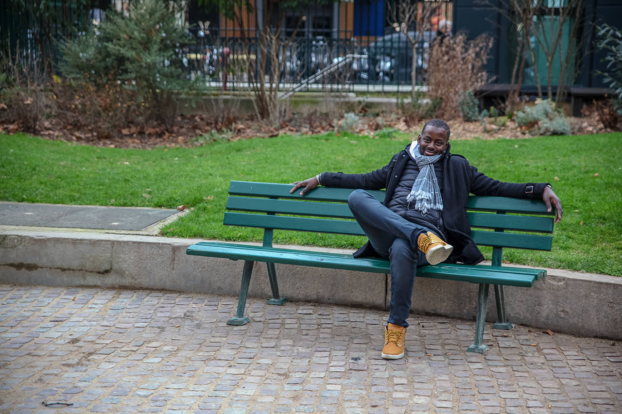 Demba relaxing on a bench