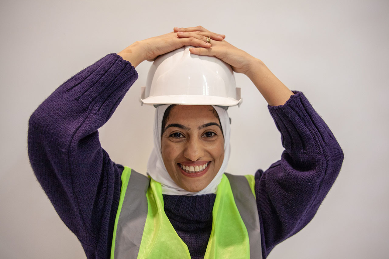 Manahil smiling in hard hat