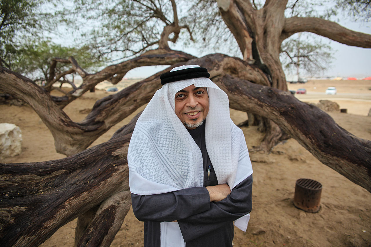 Zakareya smiling in front of tree of life